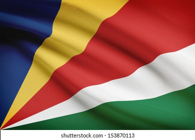 Seychelloise flag blowing in the wind. Part of a series.