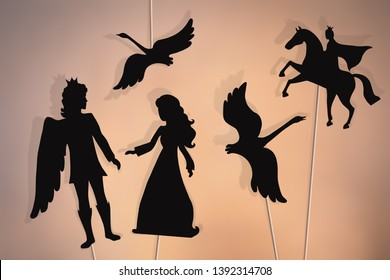 Shadow puppets of enchanted wild swans, princess and prince.