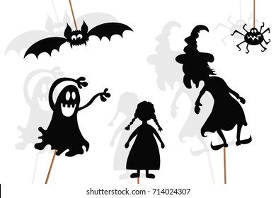 Shadow puppets of little girl, evil witch, spider, ghost and vampire bat, isolated on white background.