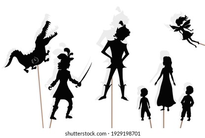 Shadow puppets of Peter Pan, girl and boys, Captain Hook, Tinker Bell and Crocodile, isolated on white background. Peter Pan storytelling.