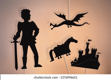 Shadow puppets of valiant knight, flying dragon, castle and knights horse.