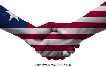 shaking hands Liberia flag on isolated white background