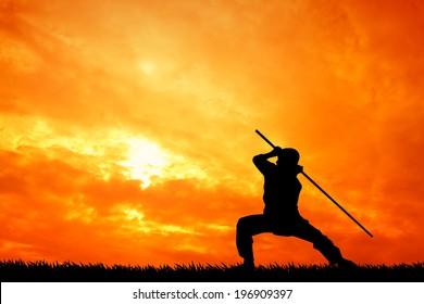 Shaolin pose at sunset