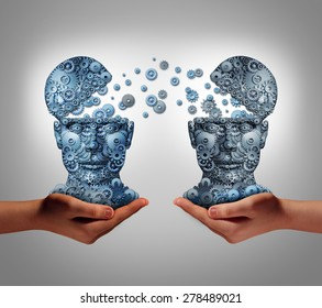 Sharing technology business concept as hands holding two human heads made of gears and cog wheels exchanging information as a symbol and financial metaphor for buying and selling or share data.