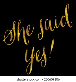 She Said Yes Gold Faux Foil Metallic Glitter Wedding or Engagement Quote Isolated on Black Background