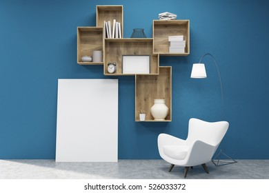 Shelfs with books, vases and boxes attached to a blue wall. There is a large vertical poster under them and an armchair. 3d rendering. Mock up