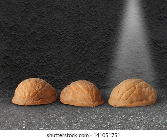 Shell game with three walnut shells on a city street with a light shinning on the winning choice as a business concept of choosing the right investment with the assistance of professional guidance.