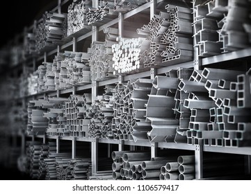Shelves of different metal products. Profiles and tubes. 3d illustration