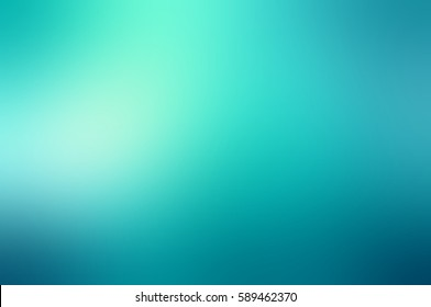Shining deep ocean underwater background. Glow blue green blurred background. Empty abstract water backdrop.