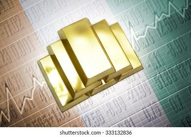 Shining golden bullions lie on a ivorian flag background