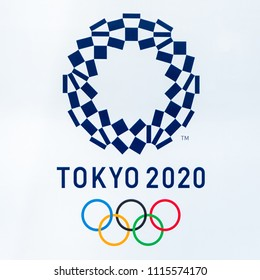 SHINJUKU TOKYO, JAPAN - June 8, 2018 : 2020 Tokyo Olympics logo symbol on Metropolitan Government Building In the middle city is Landmarks in Tokyo Japan on June 8, 2018.