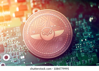 shiny copper GNOSIS cryptocurrency coin on blurry motherboard background