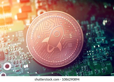 shiny copper STELLAR cryptocurrency coin on blurry motherboard background