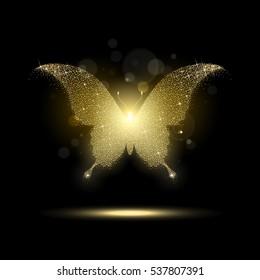 shiny golden butterfly on a black background
