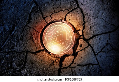shiny golden DASH cryptocurrency coin on dry earth dessert background mining