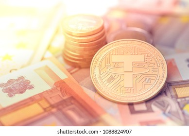 shiny golden TETHER cryptocurrency coin on blurry background with euro money