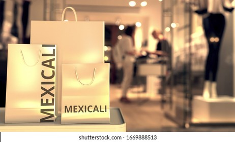 Shopping bags with Mexicali caption against blurred store entrance. Shopping in Mexico related conceptual 3D rendering