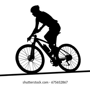 Side profile silhouette of male mountain bike racer riding bicycle