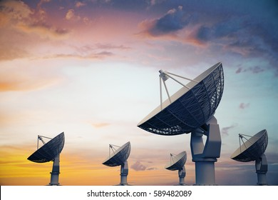 Side view of backlit satellites on beautiful sky background. Exploration concept. 3D Rendering