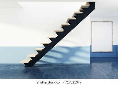 Side view of a black and wooden staircase in a large empty apartment with white and blue walls and a concrete floor. A framed vertical poster on the wall. 3d rendering mock up