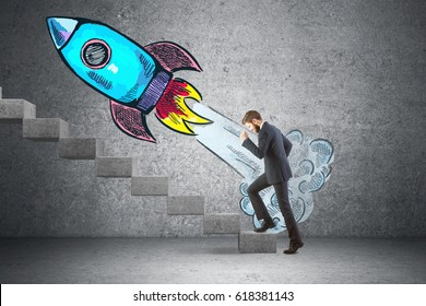 Side view of businessman climbing concrete stairs in interior with launching rocket sketch. Startup cpncept. 3D Rendering