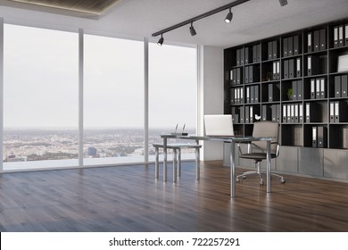 Side view of a CEO office interior with a wooden floor, a panoramic window, a large black bookcase and a table with a laptop on it. 3d rendering