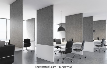 Side view of concrete coworking office interior design with laptops on workplaces, ceiling lamps and daylight. 3D Rendering