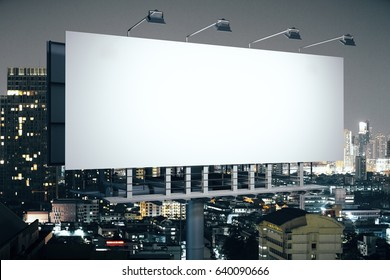 Side view of empty banner on illuminated night city background. Advertisement concept. 3D Rendering