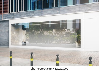 Side view of empty glass storefront in daylight. Advertisement concept. Mock up, 3D Rendering