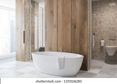 Side view of luxury bathroom with wooden walls, white tile floor, and white bathtub. Vertical mirror and a toilet. 3d rendering copy space