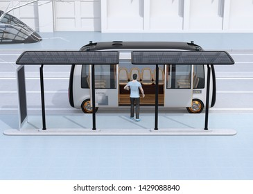 Side view of a man get on a autonomous bus. The bus stop equipped with solar panels. 3D rendering image.