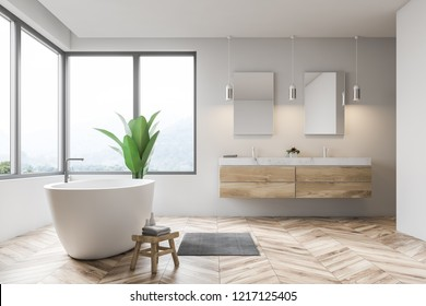 Side view of modern bathroom interior with white walls, wooden floor, window with beige curtains, white bathtub and double sink. 3d rendering