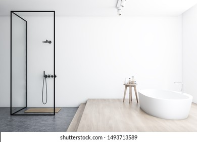 Side view of modern bathroom with white walls, concrete and wooden floor, comfortable white bathtub and walk in shower with glass walls. 3d rendering