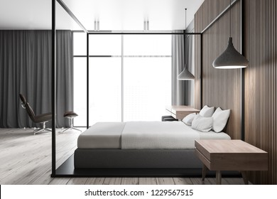 Side view of modern bedroom interior with wooden walls and floor, master bed and make up table and brown armchair standing near panoramic window with gray curtains. 3d rendering