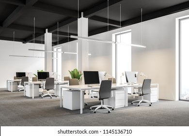 Side view of a modern international company office with white walls, and white computer desks standing in rows. Industrial style. Black ceiling. 3d rendering mock up