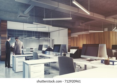 Side view of an open space office environment with dark wooden, white and glass walls, rows of white computer desks and original ceiling lamps. People. 3d rendering mock up toned image