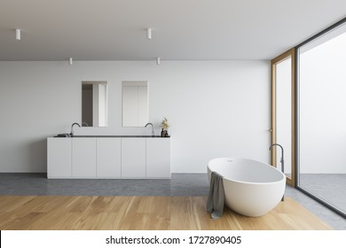 Side view of panoramic bathroom with white walls, concrete and wooden floor, comfortable bathtub and double sink with vertical mirrors. 3d rendering