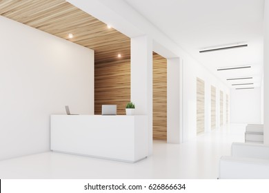 Side view of a reception desk standing in an office with light wooden wall elements. 3d rendering, mock up