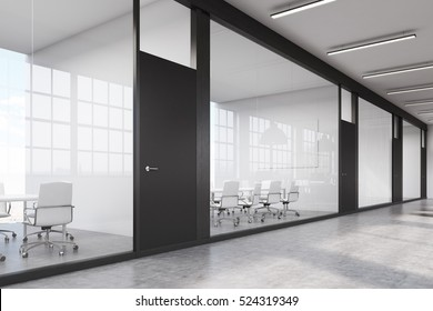 Side view of a row of meeting rooms in a long corridor. Glass walls, black doors. Concept of communication. 3d rendering.