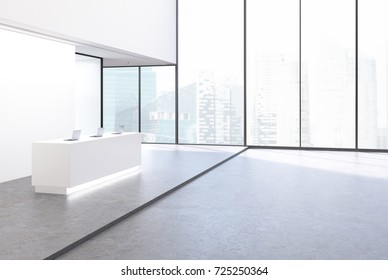 Side view of a white reception desk standing in an office lobby with pannel walls and large windows. A beautiful cityscape. 3d rendering mock up