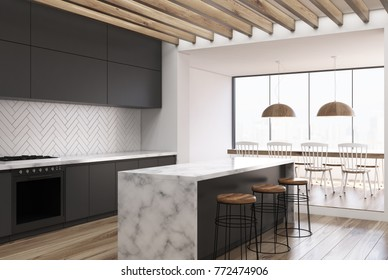 Side view of a white wooden kitchen with a white marble bar, black countertops and a dining room table with chairs. 3d rendering mock up