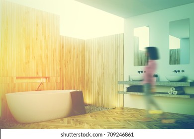 Side view of a wooden bathroom with a white tub, a black towel hanging on it and a wooden and rubble floor and a double sink on the left. Woman. 3d rendering mock up toned iamge