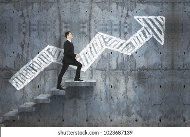 Side view of young businessman climbing stairs on abstract concrete background with drawn arrow. Career and forward concept. 3D Rendering
