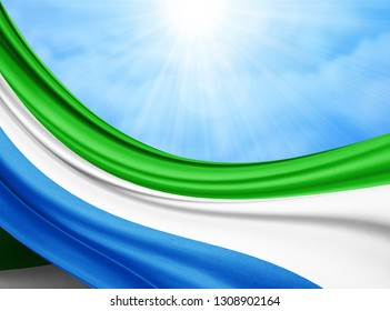 Sierra Leone   flag of silk with copyspace for your text or images and sky background-3D illustration