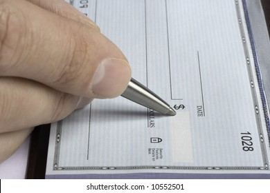 Signing a blank check with a chrome pen