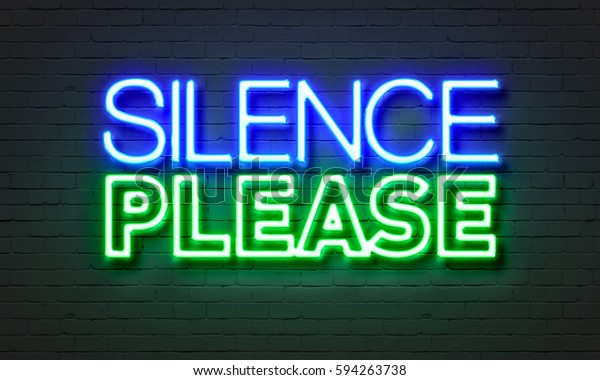Silence please neon sign on brick wall background