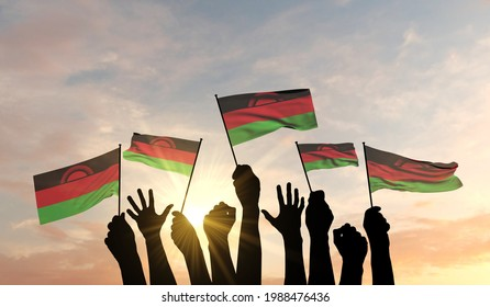 Silhouette of arms raised waving a Malawi flag with pride. 3D Rendering