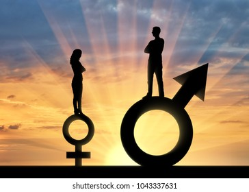 Silhouette of a big man and a small woman standing on gender symbols. The concept of gender inequality and discrimination