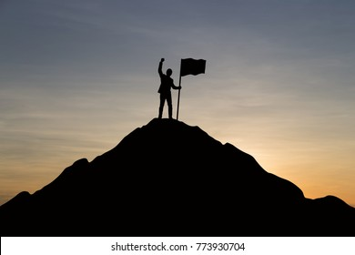 Silhouette of businessman celebrating success on top mountain, sky and sun light background. Business, successful, leadership, achievement and goal concept.
