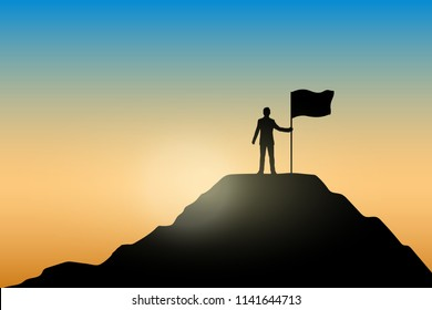 Silhouette of businessman holding a flag on top mountain, sky and sun light background.  Business, success, leadership, achievement and goal concept.